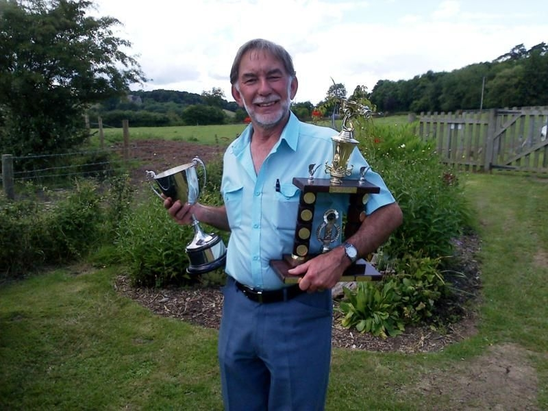 John with his haul for Winner of 'Best Car'  and 'Best Engine Bay' at Founder's Day